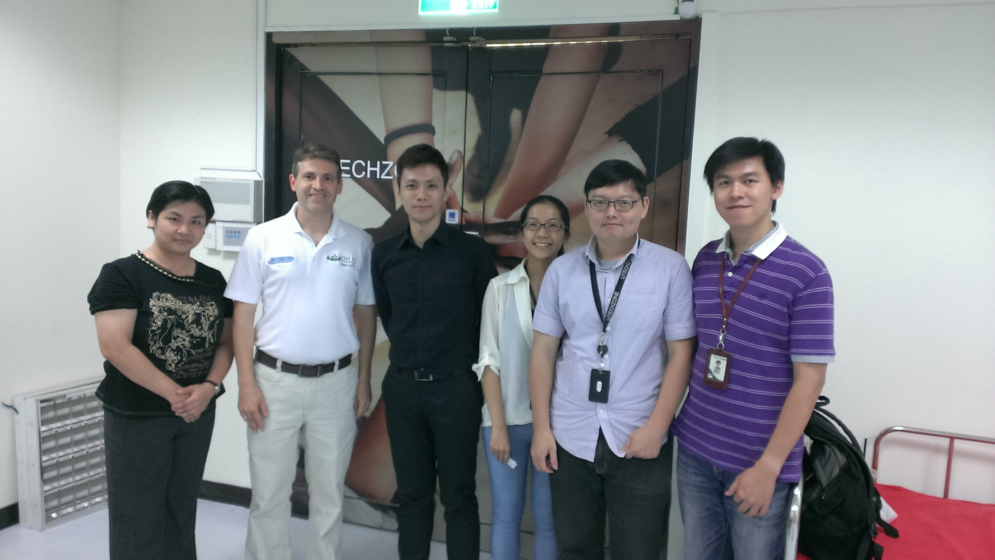 Photo of John McCarthy with Utechzone developers